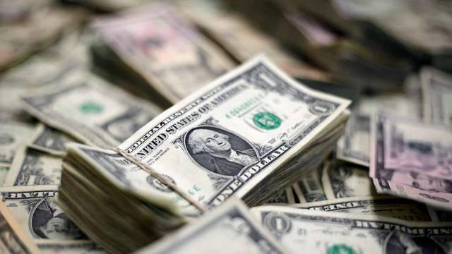 عملة الدولار التي يرتبط بها سلة العملات  بخمس دول خليجية، الصورة أرشيفية