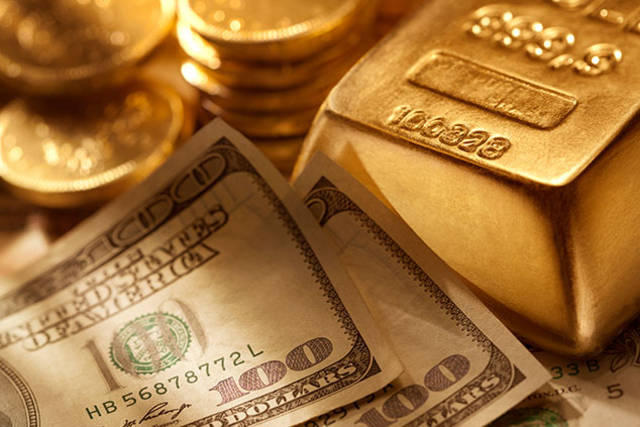 Gold rises Tuesday as dollar declines after soft US data