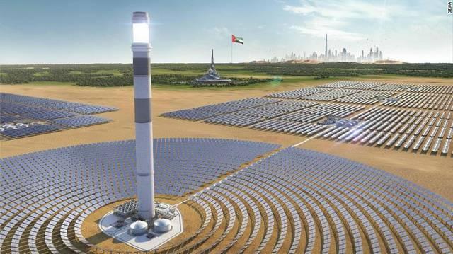 بالصور.. استكمال قاعدة أطول برج للطاقة الشمسية بالعالم في دبي