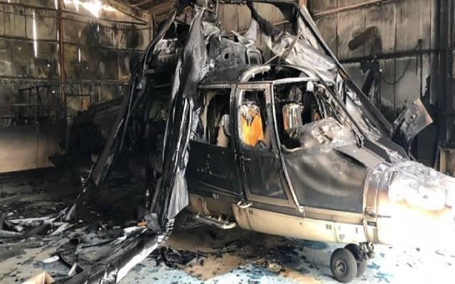 الطائرة المحترقة في جناح طیران الشرطة بقاعدة (عبدالله المبارك) الجویة بمطار الكویت الدولي