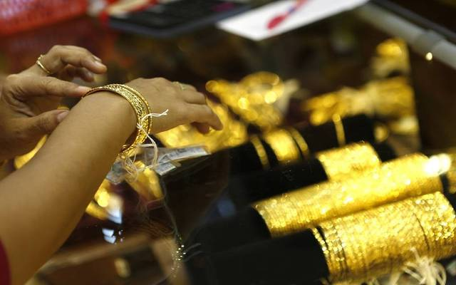 Gold settles $18 lower on Friday