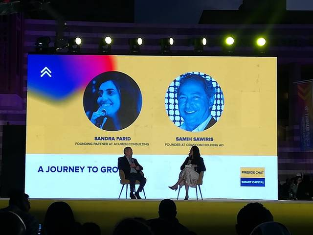 Sandra Farid interviewing Samih Sawiris during RiseUp Summit 2019