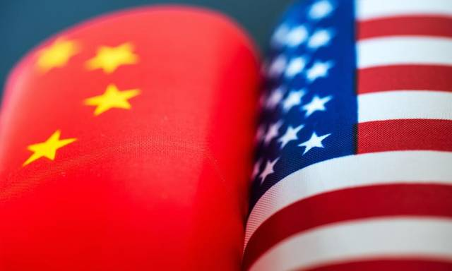 China, US agree to roll back tariffs as talks proceed