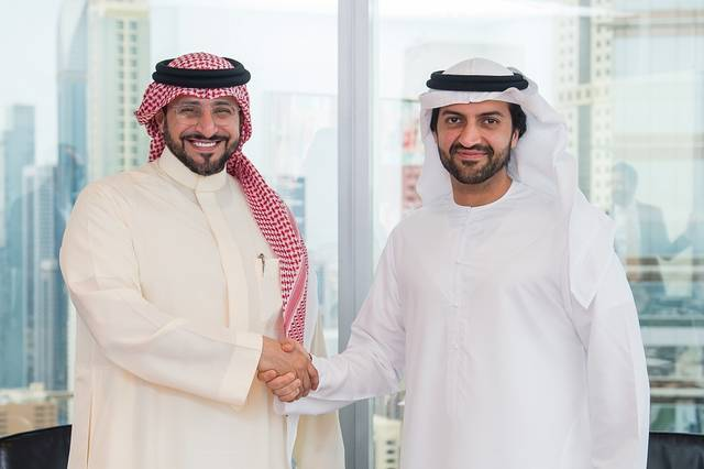 Jabal Omar CEO Yasser Al-Sharif and SHUAA Capital chairman Jassim Alseddiqi