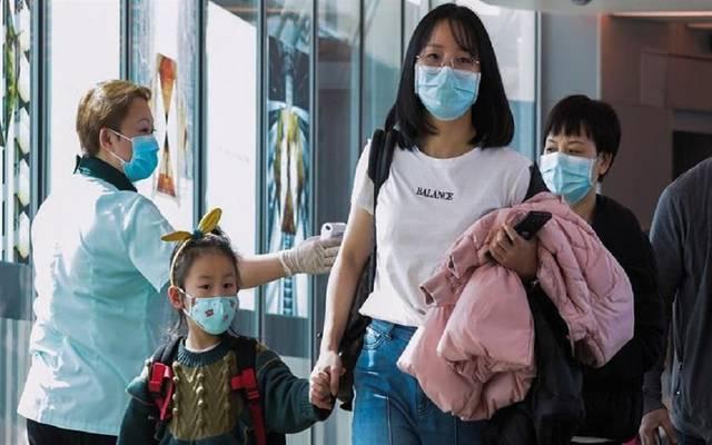 """صورة تعبيرية عن مخاوف بشأن انتشار فيروس """"كورونا"""" عالمياً"""