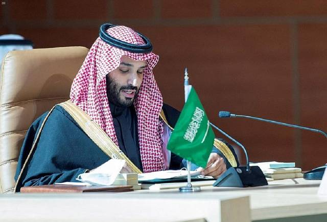 Saudi Arabia's Crown Prince Mohammed bin Salman signing the agreements.