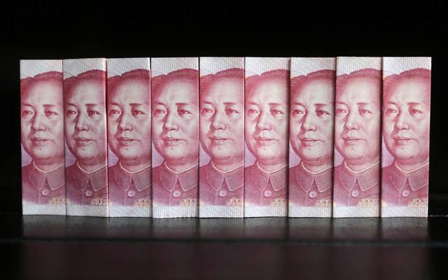 اليوان الصيني يرتفع بأعلى وتيرة في شهر أمام الدولار