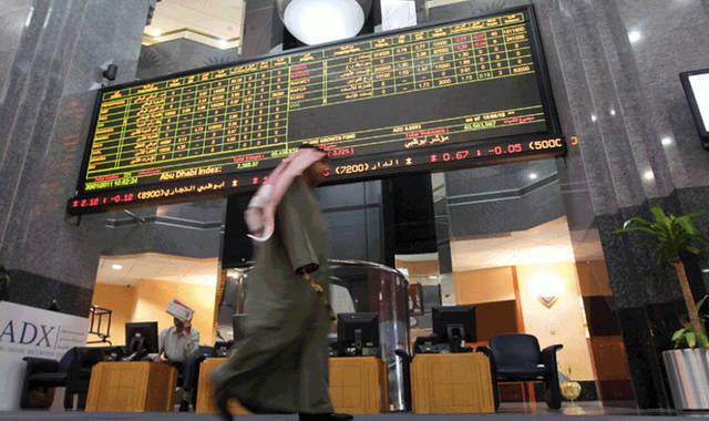 متعاملون بسوق أبوظبي المالي