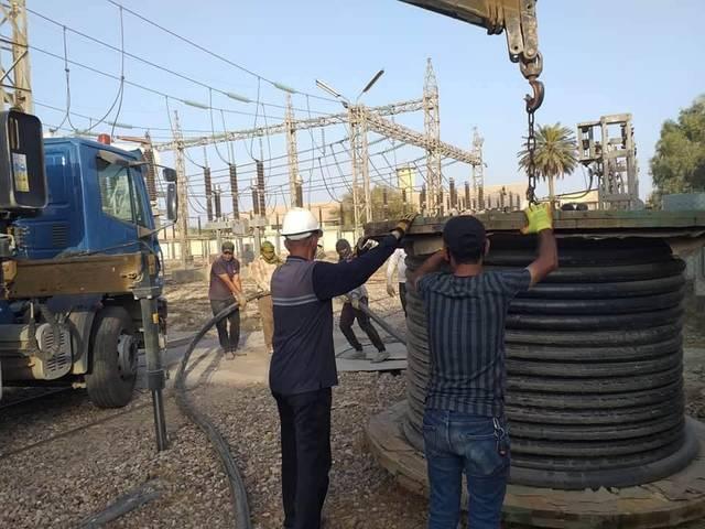 مد كابلات كهرباء في محافظة واسط العراقية، أرشيفية