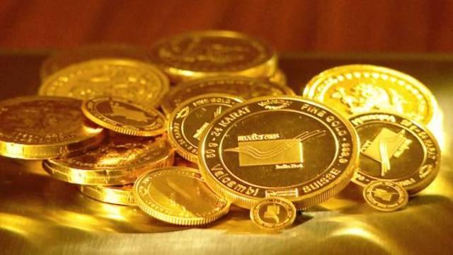 الذهب يتراجع في التعاملات الآسيوية مع صعود الدولار