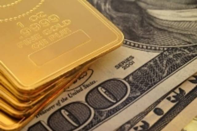 Gold drops on stronger dollar, but rate-cut hopes keep lid