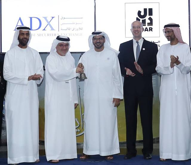 Officials from the ADX and Aldar Investments during the bell-ringing ceremony on Sunday