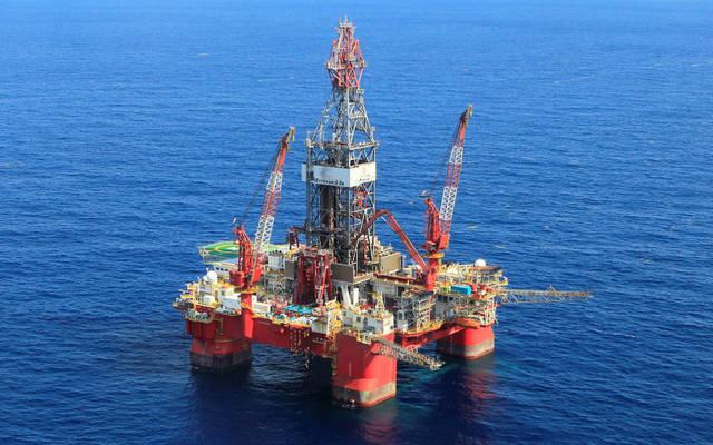 Oil prices down; Brent falls below $58