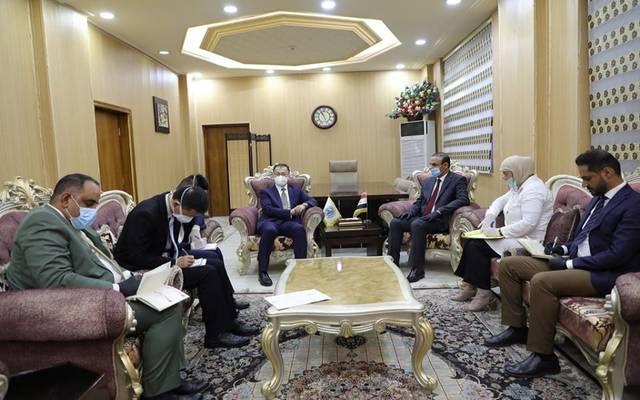 وزير العمل والشؤون الاجتماعية العراقي، عادل الركابي، والسفير الصيني لدى العراق، تشانغ تاو