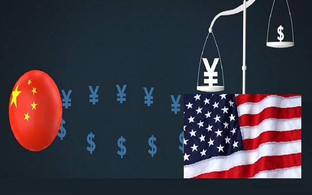 مع ارتباط اليوان بالدولار.. من يتلاعب في قيمة عملته حقاً؟
