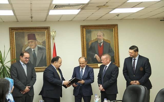 جانب من توقيع اتفاق التسوية