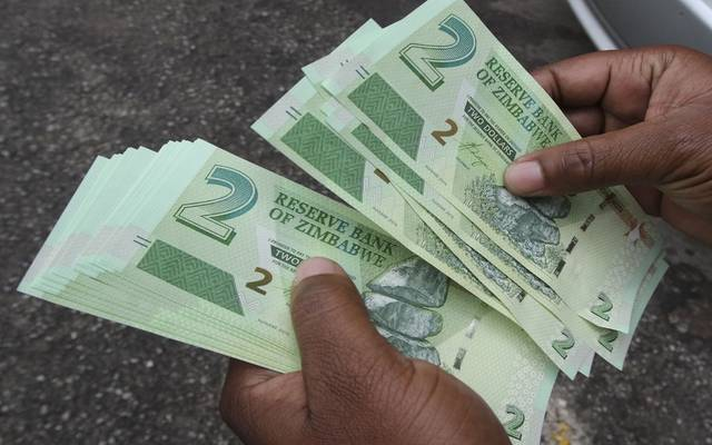 Crowding in front of banks in Zimbabwe as the new currency begins trading