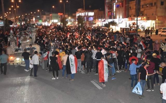 مواطنون عراقيون خلال التظاهرات الأخيرة التي شهدتها البلاد