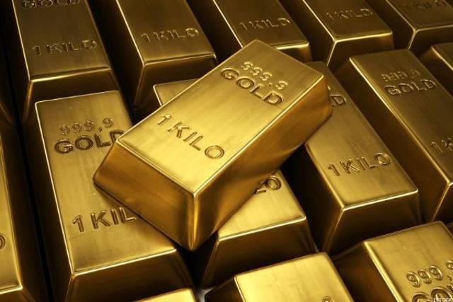 Gold drops beyond 1-week trough on firmer dollar