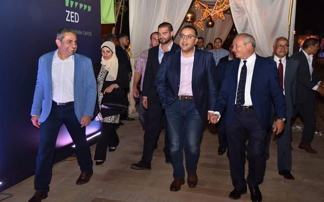 رئس مجلس الوزراء مصطفى مدبولي و رجل الأعمال نجيب ساويرس