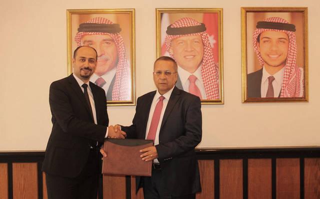 جانب من توقيع اتفاقية بين الشركة الاردنية لإعادة تمويل الرهن العقاري والعربية الوطنية للتأجير