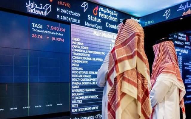 """متعاملان بسوق الأسهم السعودية """"تداول"""""""