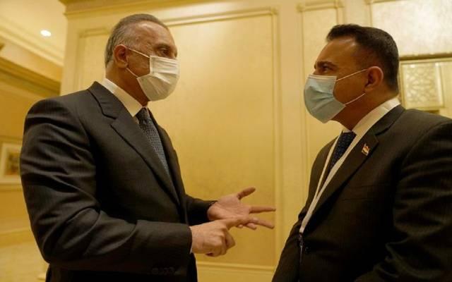 رئيس الحكومة العراقية مع وزير الصحة حسن التميمي