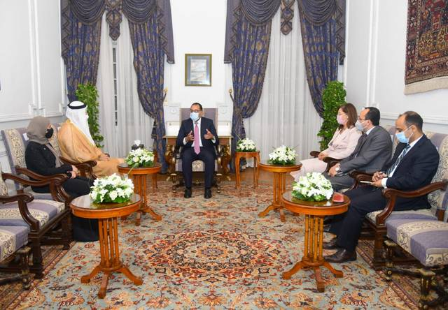 مصطفى مدبولي مع محمد القرقاوي