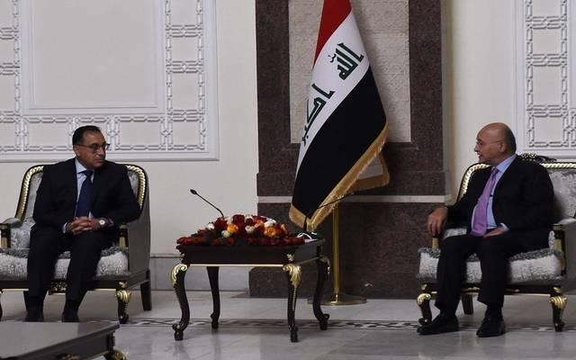 رئيس الوزراء المصري خلال لقاء الرئيس العراقي