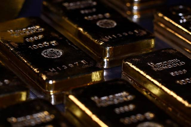 Gold rises; heads for biggest weekly drop in 2.5 years