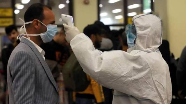 فحص فيروس كورونا لأحد المواطنين بمستشفى بالعراق