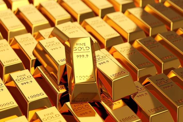 Gold prices ease near $1,800 on taper uncertainty