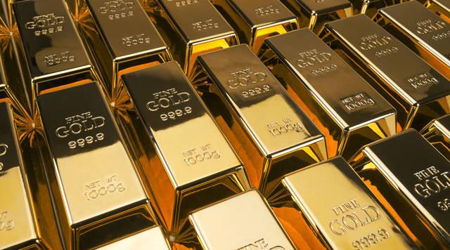 Gold edges down Wednesday as risk sentiment improves