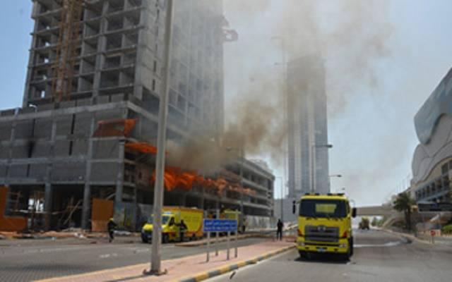 الحريق شب بالطابق العلوي وبسبب ظروف الطقس غير المستقرة انتقل الحريق إلى الطابق الرابع