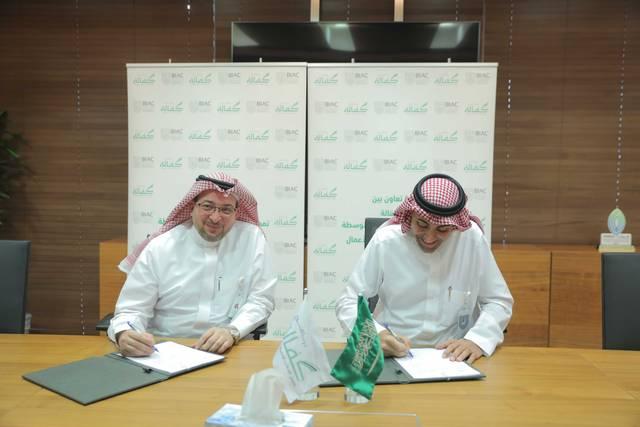 Kafalah GM Homam Hashem and BIAC CEO Nawaf Al Sahhaf signing the agreement