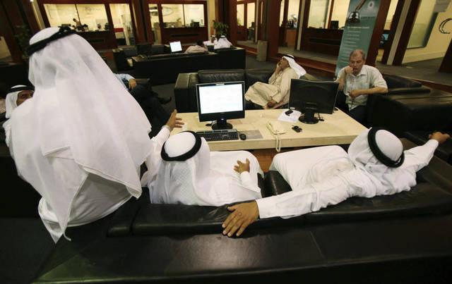 Traders at Dubai's bourse