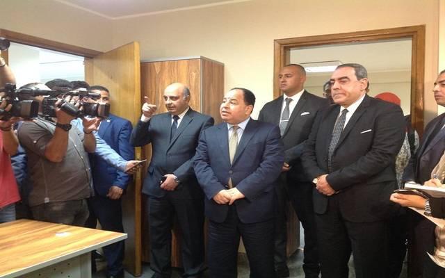 وزير المالية خلال افتتاحه المقر الرئيسي المؤقت للهيئة العامة للتأمين الصحي الشامل