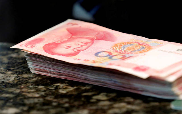 Chinese yuan widens losses at 13-month low