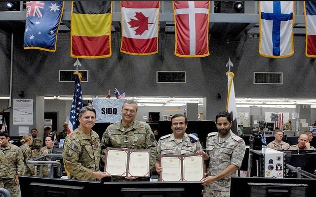 جانب من توقيع الاتفاقية بين الطرفين القطري والأمريكي