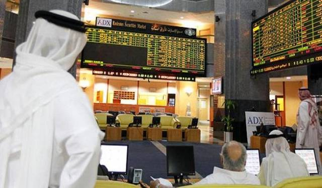 Traders at Abu Dhabi's bourse