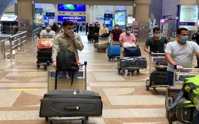 وصول مصريين قادمين من الكويت إلى مطار القاهرة ـ أرشيفية