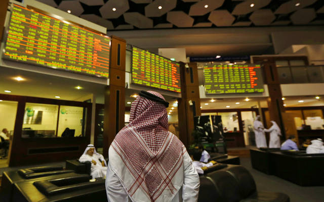 Traders at Dubai's bourse