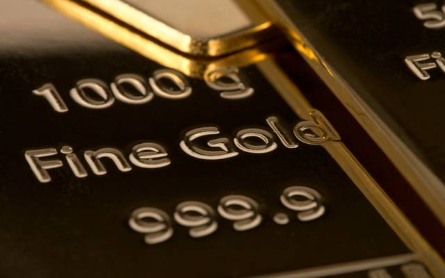 Gold slips early Tuesday as dollar firms before US-China talks