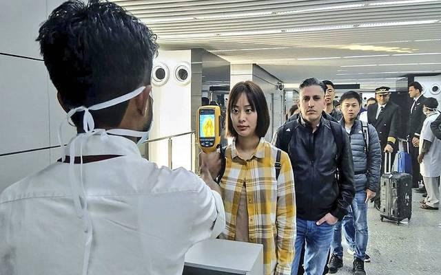 فحص الإصابة بفيروس كورونا في المطارات