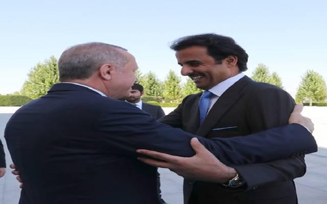 الرئيس التركي خلال استقبال أمبير قطر الشيخ تميم بن حمد آل ثان