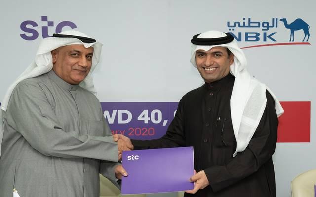 خلال توقيع الاتفاقية بين بنك الكويت الوطني وشركة الاتصالات الكويتية
