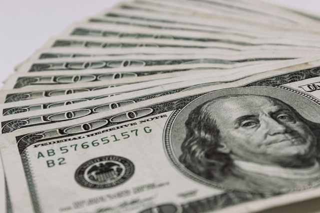 US dollar firms on positive US data amidst light trade