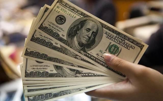 بيع المبالغ المحولة لحسابات المصارف في الخارج بسعر 1190 ديناراً لكل دولار